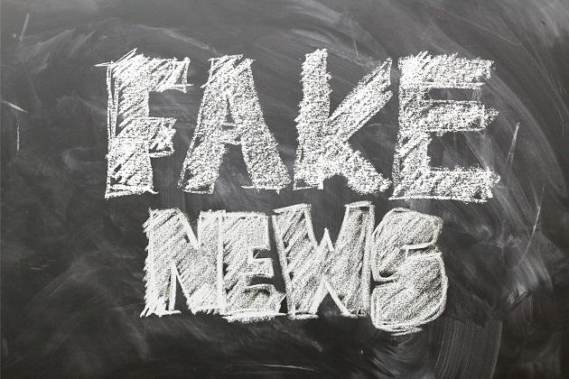 Membagikan atau memposting berita hoax